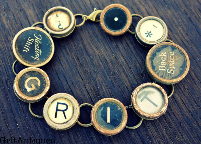 "Vintage Typewriter Keys spell out ""Grit"""