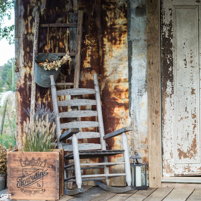 Decorating the barn porch for fall.