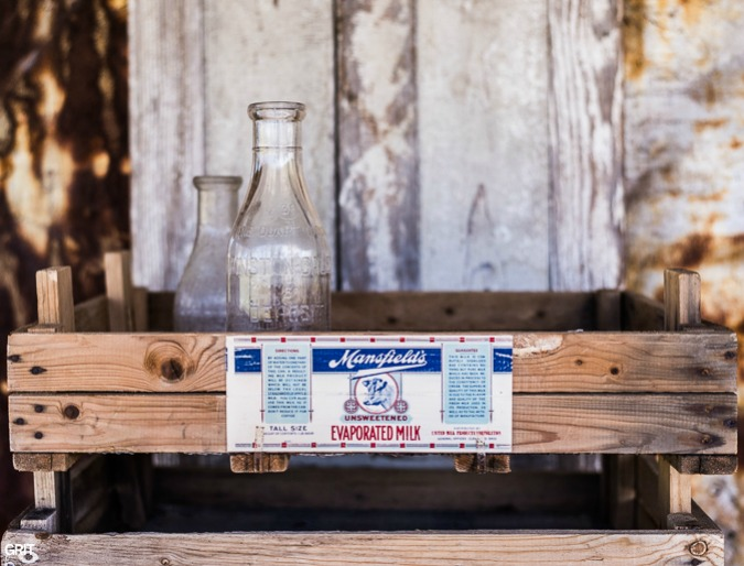 Decorating an old seed tray with vintage labels and modpodge