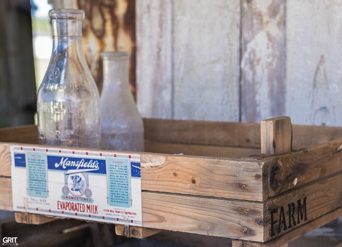 Using Mod Podge, vintage dairy label, and an old seed tray to create a farmhouse style tray.
