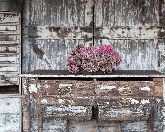 Flea Market Decor styled with dried hydrangeas and old doors.